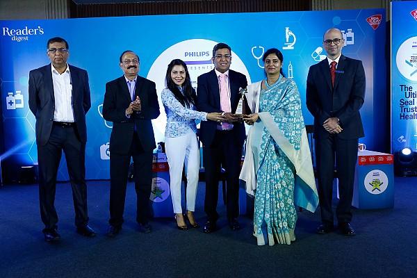 Dr. Tarang Krishna with Dr. Deepika Krishna receiving Reader's Digest Award from the Union health minister Anupriya Patel